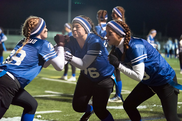 11/19/18 Wesley Bunnell | Staff Southington powder puff football vs Rocky Hill on Monday night at Southington High School. Mary Bilodeau (38) and Ashley Schiffer (76) middle.