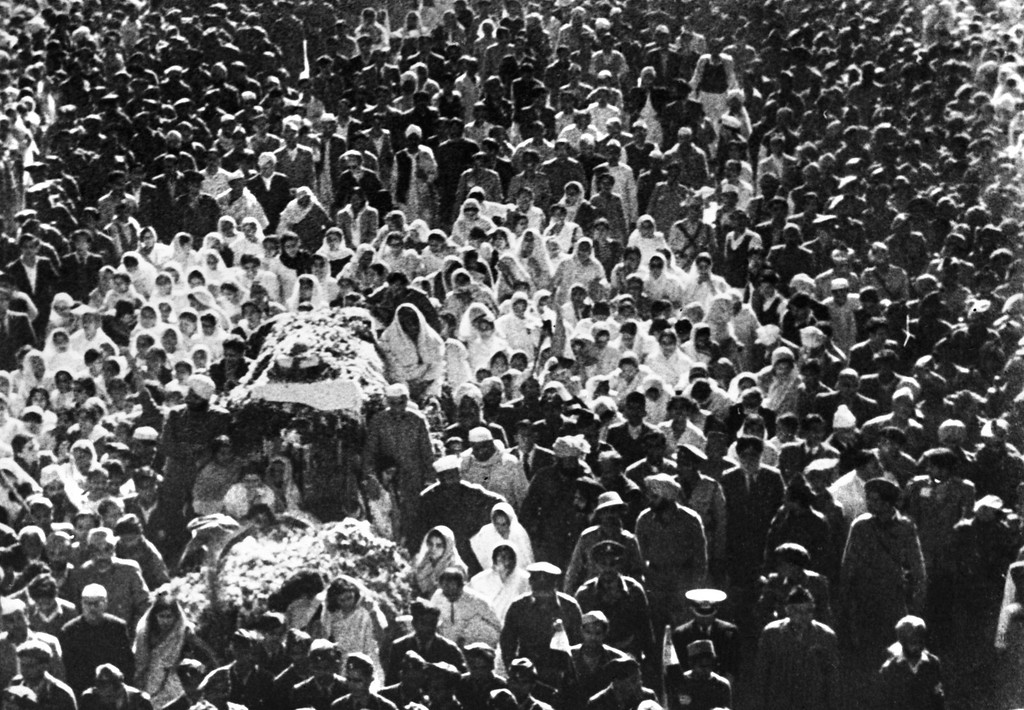 . The body of martyred Mohandas Karamchand Gandhi, known as the Mahatma Gandhi (1869-1948), is borne, 10 February 1948, in New Delhi, for the ceremony of cremation. Almost one million people took part in the Mahatma Gandhi\'s funeral procession to reach the cremation grounds near New Delhi and mourn their leader, slain by an assassin�s bullets as he walked to prayer at Birla House. (Photo credit should read OFF/AFP/Getty Images)