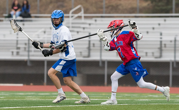 04/18/19 Wesley Bunnell | Staff Berlin boys lacrosse defeated Bristol Eastern at on Thursday afternoon at Bristol Eastern High School. Eastern's Noah Piazza (18) and Berlin's Cole Primo (7).