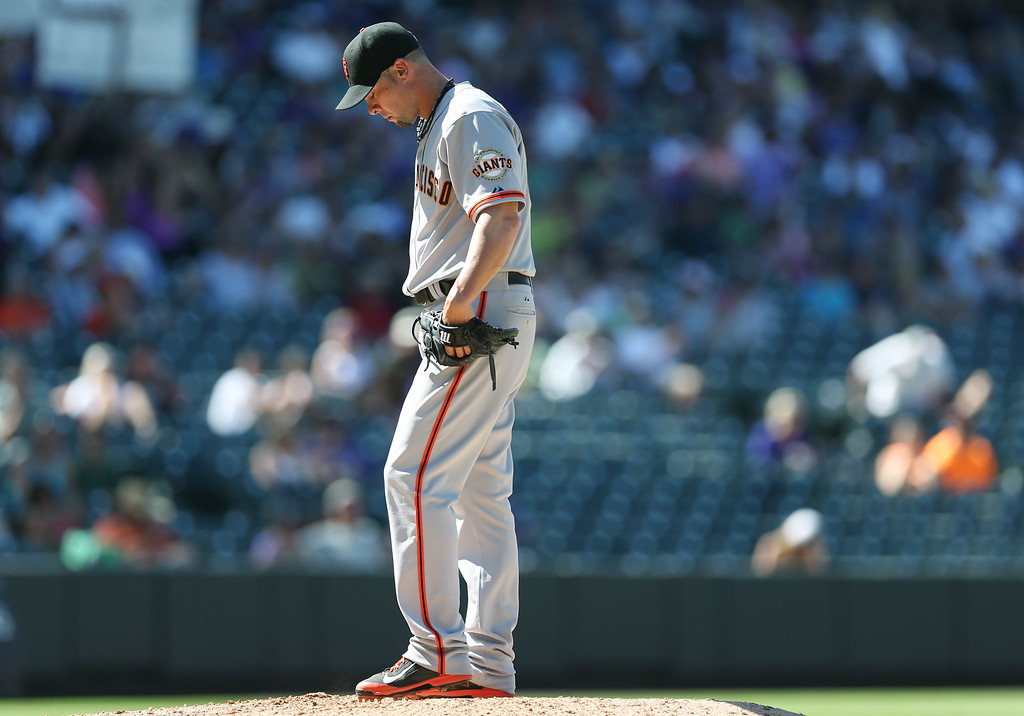 . San Francisco Giants starting pitcher Ryan Vogelsong waits to be pulled from the mound against the Colorado Rockies in the sixth inning of a baseball game in Denver, Wednesday, Sept. 3, 2014. The Rockies won 9-2. (AP Photo/David Zalubowski)