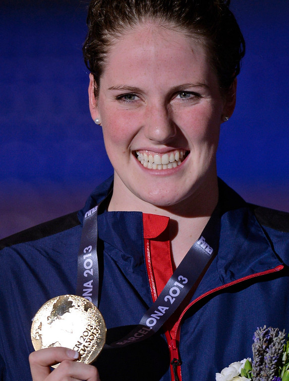 . Missy Franklin of the United States smiles as she holds her gold medal after the presentation ceremony for the Women\'s 100m backstroke final at the FINA Swimming World Championships in Barcelona, Spain, Tuesday, July 30, 2013. (AP Photo/Manu Fernandez)