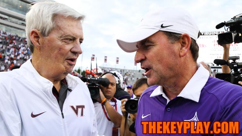Virginia Tech head coach Frank Beamer (left) shakes hands with Furman head coach Bruce Fowler. (Mark Umansky/TheKeyPlay.com)