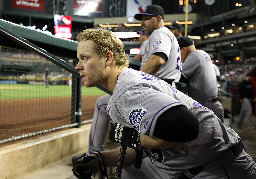 . Justin Morneau #33 of the Colorado Rockies watches from the dugout during the MLB game against the Arizona Diamondbacks at Chase Field on April 29, 2014 in Phoenix, Arizona.  (Photo by Christian Petersen/Getty Images)