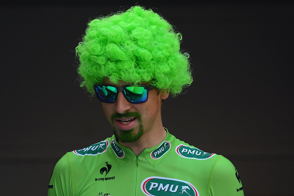 . Best sprinter\'s green jersey Slovakia\'s Peter Sagan, is seen leaving the signature ceremony, and wearing a green wig, with his beard tinted in green to celebrate his green jersey of best sprinter, in Versailles, outside Paris, at the departure village, before the start of the 133.5 km twenty-first and last stage of the 100th edition of the Tour de France cycling race on July 21, 2013 between Versailles and Paris.  JOEL SAGET/AFP/Getty Images