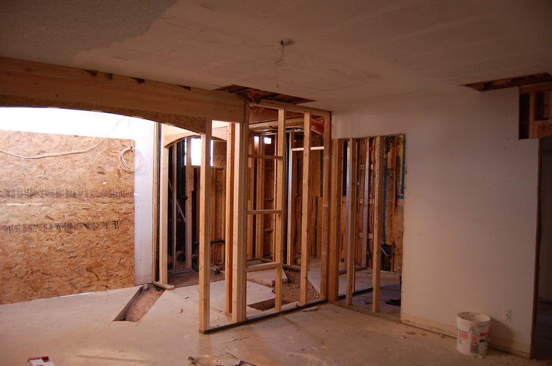 This is the master bedroom, looking toward the back of the house. You can see the concrete cut for the eventual bathtub, if ever we decide to install it.