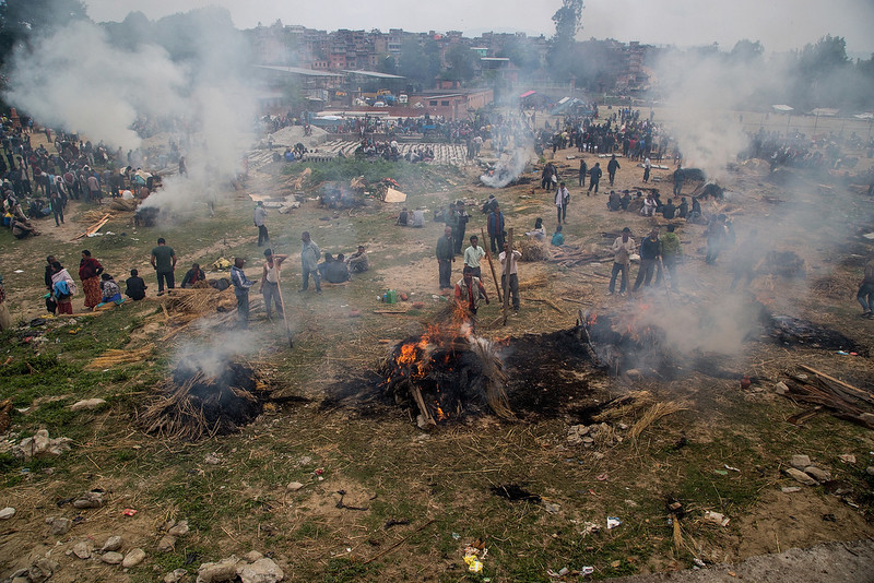 . Victims of the earthquake that hit Nepal yesterday are cremated on April 26, 2015 in Bhaktapur, Nepal. A major 7.8 earthquake hit Kathmandu mid-day on Saturday, and was followed by multiple aftershocks that triggered avalanches on Mt. Everest that buried mountain climbers in their base camps. Many houses, buildings and temples in the capital were destroyed during the earthquake, leaving thousands dead or trapped under the debris as emergency rescue workers attempt to clear debris and find survivors.  (Photo by Omar Havana/Getty Images)