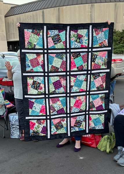 Carolyn Solomon showing us a Gudrun Erla quilt .  I think the pattern is Emily