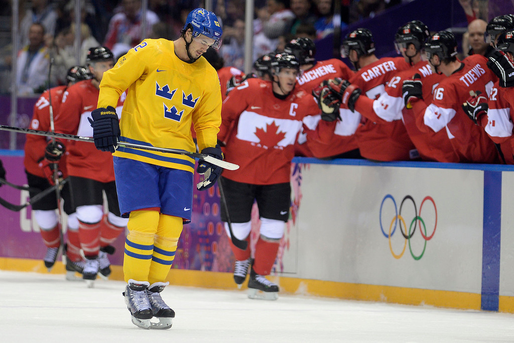 . Jonathan Ericsson (52) of Sweden reacts to a 2-0 goal by Sidney Crosby (87) of Canada during the second period of the men\'s ice hockey gold medal game. Sochi 2014 Winter Olympics on Sunday, February 23, 2014 at Bolshoy Ice Arena. (Photo by AAron Ontiveroz/ The Denver Post)