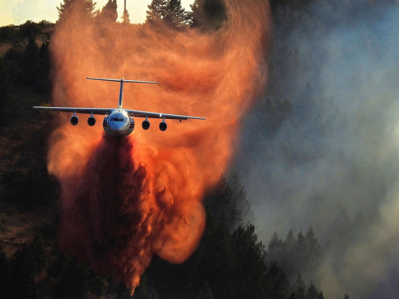 Avro RJ85 airtanker dropping a line of retardant on the Eight Mile fire in Idaho by Melissa Kimsey.jpg