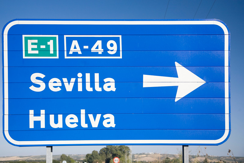 Traffic plate with the words Sevilla and Huelva, Spain