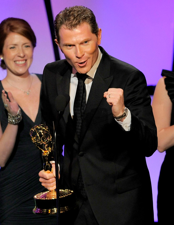 """. Bobby Flay accepts the culinary program award for \""""Barbecue Addiction\"""" onstage at the 39th Annual Daytime Emmy Awards at the Beverly Hilton Hotel on Saturday, June 23, 2012 in Beverly Hills, Calif. (Photo by Chris Pizzello/Invision/AP)"""