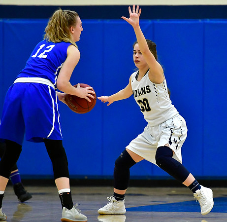 3/1/2019 Mike Orazzi | Staff Newington High School''s Marly Zocco (30) and the Glastonbury Tomahawks' Chelsea Tacey (12) during the Class LL Second Round of the CIAC 2019 State Girls Basketball Tournament at Newington High School Friday night.