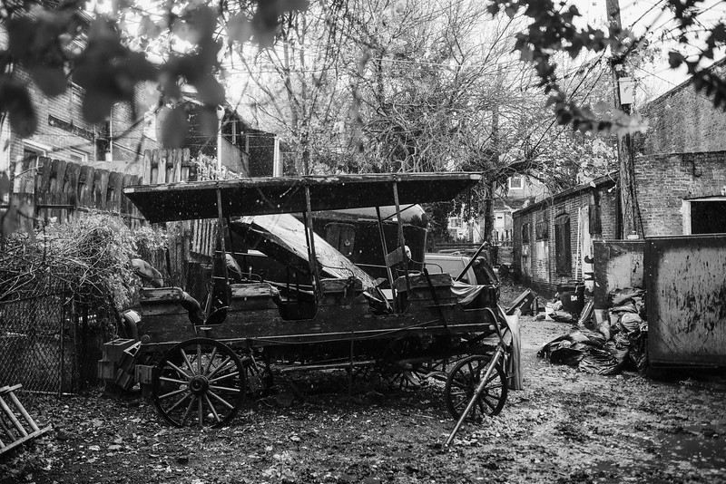 Baltimore -- One of several broken wagons on the Cartlon Street Stables grounds. The rain pours on Nov. 9, 2018.