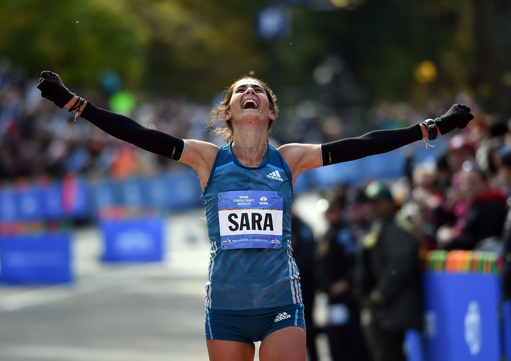 . Sara Moreira of Portugal crosses the finish third in the women\'s 2014 TCS New York City Marathon November 2, 2014 in New York.   AFP PHOTO/Don EmmertDON EMMERT/AFP/Getty Images