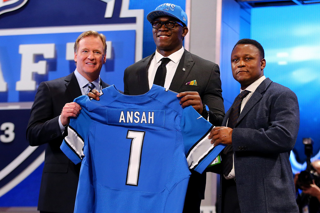 . Ezekiel Ansah of the BYU Cougars stands with NFL Commissioner Roger Goodell (L) and Pro Football Hall of Famer Barry Sanders (R) as they hold up a jersey on stage after Ansah was picked #5 overall by the Detroit Lions in the first round of the 2013 NFL Draft at Radio City Music Hall on April 25, 2013 in New York City.  (Photo by Al Bello/Getty Images)