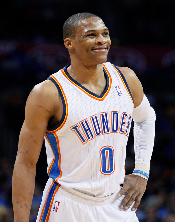 . Oklahoma City Thunder guard Russell Westbrook smiles as he takes a break after a foul call as the Thunders face the Denver Nuggets in the first half of their NBA basketball game in Oklahoma City, Oklahoma January 16, 2013. REUTERS/Bill Waugh