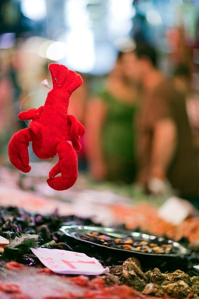 Fishmonger, Boqueria market, town of Barcelona, autonomous commnunity of Catalonia, northeastern Spain