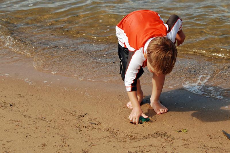 1442 Ivan finding treasures in the sand.jpg