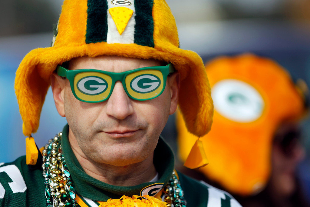 . Green Bay Packers fan Jim Zanon tailgates before an NFL football game against the Cleveland Browns Sunday, Oct. 20, 2013, in Green Bay, Wis. (AP Photo/Mike Roemer)