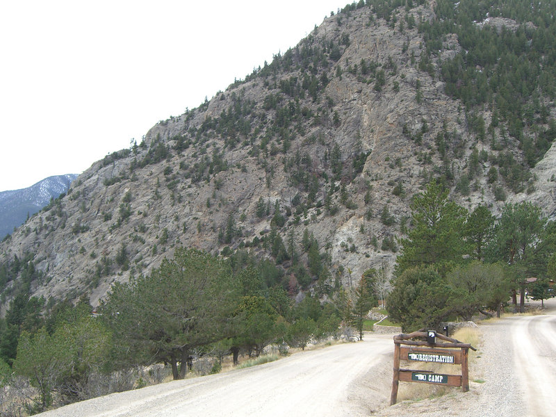 Frontier Ranch, started as a Young Life camp in 1951, is below the face of the rocky slope, hidden by the trees.
