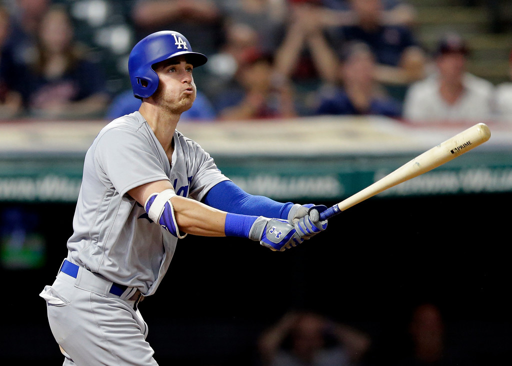 . Los Angeles Dodgers\' Cody Bellinger watches his three-run home run off Cleveland Indians relief pitcher Boone Logan during the ninth inning of a baseball game, Tuesday, June 13, 2017, in Cleveland. (AP Photo/Tony Dejak)