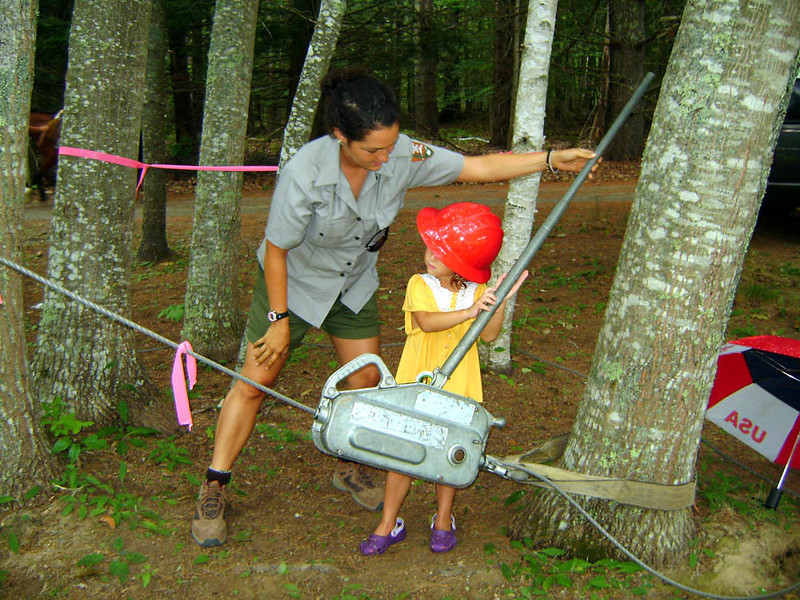 FAMILY FUN DAY Here Kaitlin shows a junior trail worker the ins and outs of using a griphoist.