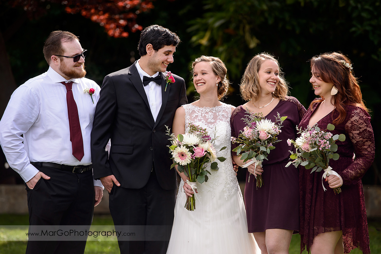 portrait of bridal party looking at each other at Fremont Century House & Gardens