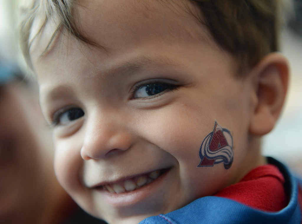 . DENVER, CO - APRIL 24: Kieron Lara, age 2, was all smiles before the game Saturday night. The Colorado Avalanche hosted the Minnesota Wild in the fifth game of a playoff series Saturday night, April 26, 2014. (Photo by Karl Gehring/The Denver Post)