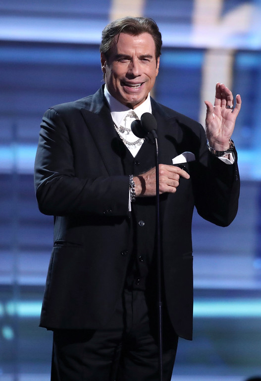 . John Travolta introduces a performance by Keith Urban and Carrie Underwood at the 59th annual Grammy Awards on Sunday, Feb. 12, 2017, in Los Angeles. (Photo by Matt Sayles/Invision/AP)
