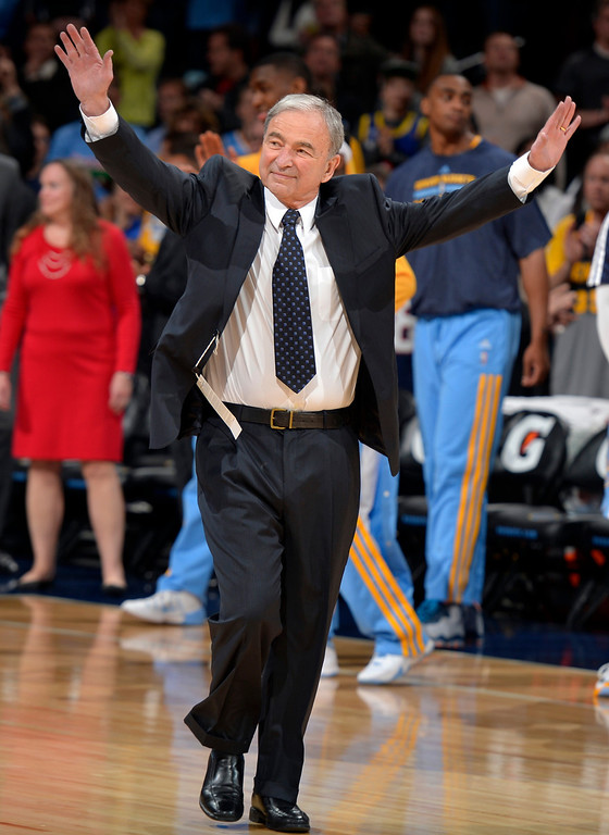 . Former Denver Nuggets executive Carl Scheer waves to fans as he is honored before the start of an NBA basketball game between the Denver Nuggets and the Indiana Pacers Saturday, Jan. 25, 2014, in Denver. (AP Photo/Jack Dempsey)