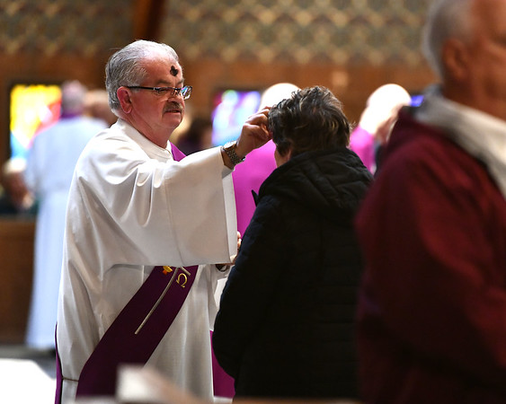 2/26/2020 Mike Orazzi | StaffrDeacon James P. McCluskey during the Ash Wednesday services at St. Matthew Church in Forestville on Wednesday.