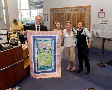 Quilt donation to Shriners Hospital