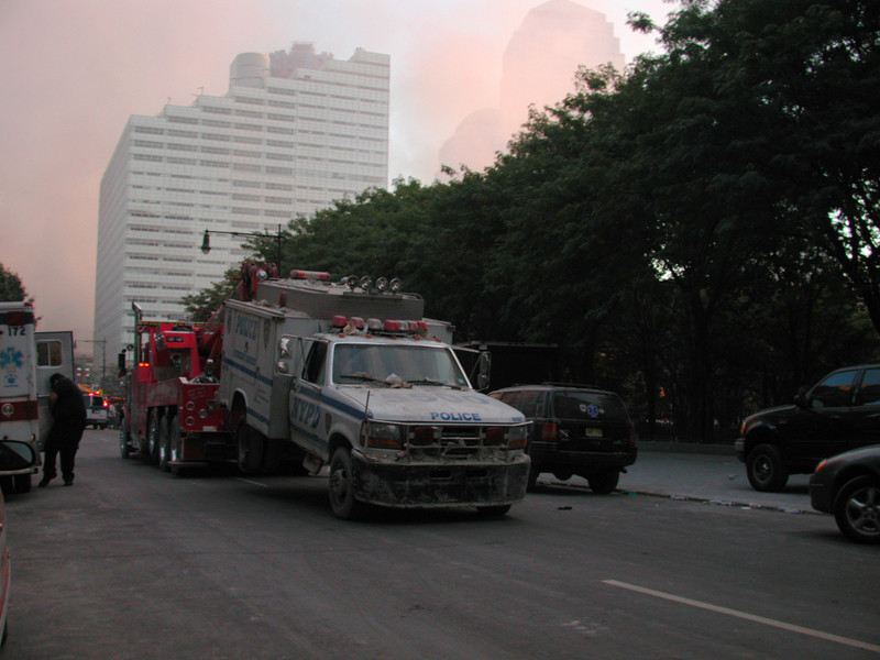 Emergency vehicles, with Ground Zero in the background.