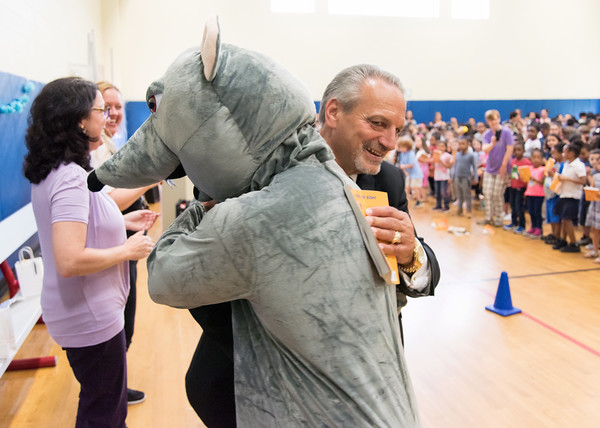 06/01/18 Wesley Bunnell | Staff CSDNB Chief Operating Officer Paul Salina dances with a mouse at Lincoln Elementary School on Friday afternoon in the school gymnasium. The school held their One School, One Book event on Friday afternoon giving every student the same book, The Mouse on the Motorcycle, to bring home to be read with their parents. The books were wrapped with the title kept a secret until being passed out.