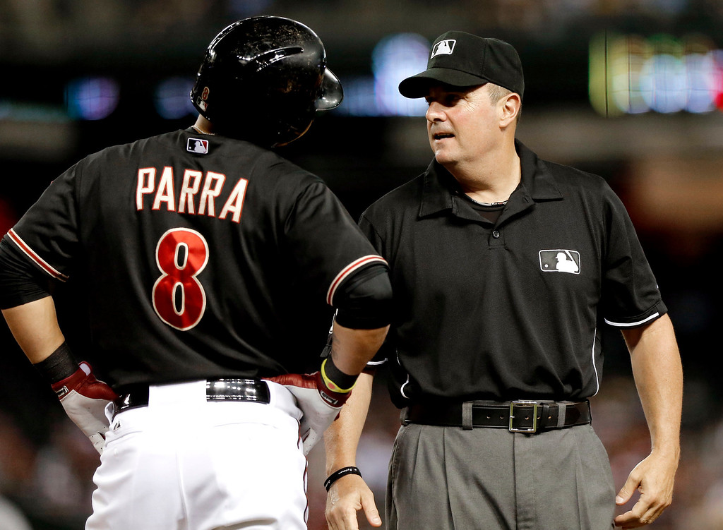 . Arizona Diamondbacks\' Gerardo Parra (8) argues a call with first base umpire Marty Foster during the third inning of a baseball game against the Los Angeles Dodgers on Wednesday, July 10, 2013, in Phoenix. (AP Photo/Matt York)
