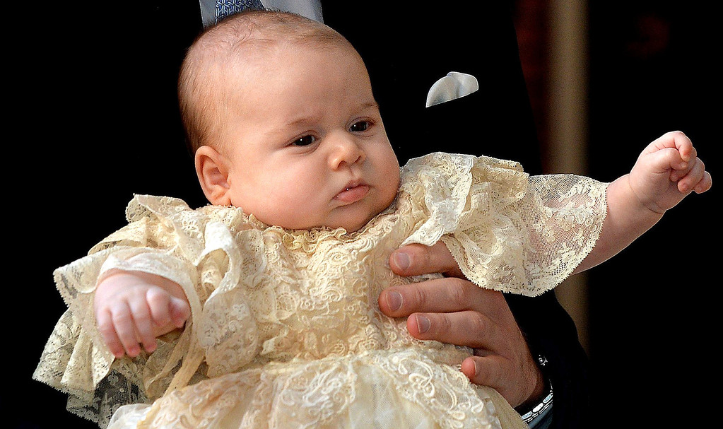 . Britain\'s Prince George is held by his father Prince William as they arrive at Chapel Royal in St James\'s Palace in London, for the christening of the three month-old Prince Wednesday Oct. 23, 2013.  (AP Photo/John Stillwell/Pool)