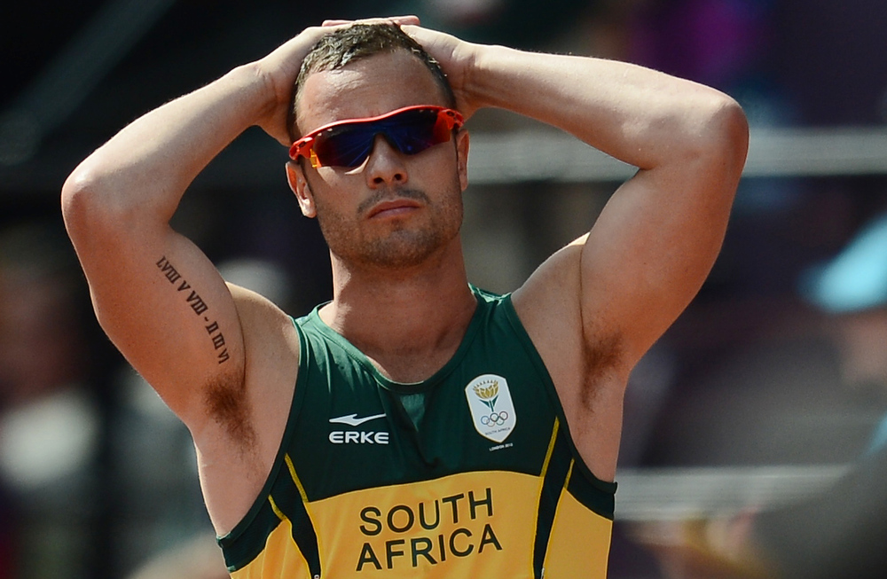 Description of . This file picture taken on August 9, 2012 in London shows South Africa's Paralympic gold medallist Oscar Pistorius who was arrested early on February 14, 2013 for allegedly shooting dead his girlfriend after mistaking her for an intruder, media reports said.  FRANCK FIFE/AFP/Getty Images