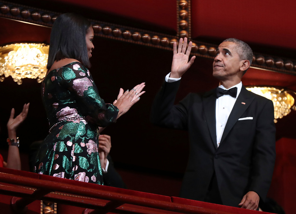 . President Barack Obama and first lady Michelle Obama, wave and applaud during the Kennedy Center Honors gala at the Kennedy Center in Washington, Sunday, Dec. 4, 2016. (AP Photo/Manuel Balce Ceneta)