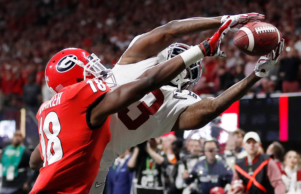 . Georgia\'s Deandre Baker knocks the ball away from Alabama\'s Calvin Ridley during the second half of the NCAA college football playoff championship game Monday, Jan. 8, 2018, in Atlanta. (AP Photo/David Goldman)
