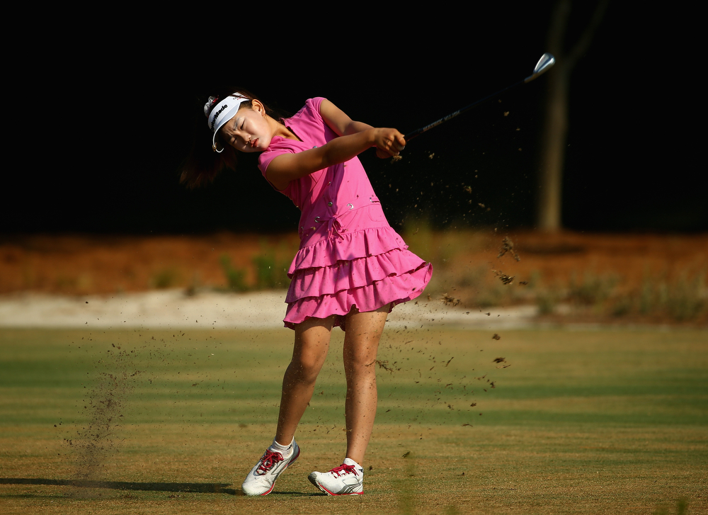 . Eleven-year old Amateur Lucy Li of the United States watches a shot during a practice round prior to the start of the 69th U.S. Women\'s Open at Pinehurst Resort & Country Club, Course No. 2 on June 18, 2014 in Pinehurst, North Carolina.  (Photo by Streeter Lecka/Getty Images)