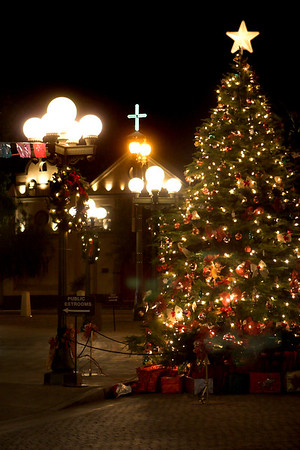 A giant Christmas Tree at the entrance to Olvera Street.  In the background a Catholic Church which shelters many of the homeless in Los Angles.
