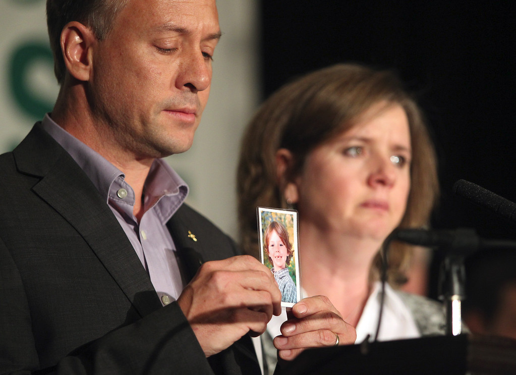 . Parents of Daniel Barden, 7, one of the victims in the Sandy Hook school shooting, Mark Barden and Jacqueline Barden hold up a photo of their son Daniel at a news conference to launch the Sandy Hook Promise Innovation Initiative held in honor of the three month anniversary of the tragic shooting at Sandy Hook Elementary School at the Bill Graham Civic Auditorium in San Francisco, Calif., on Thursday, March 14, 2013. (Anda Chu/Staff)
