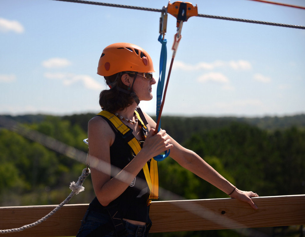 . St. Paul resident Erin Petschel waits her turn on a zip line at the Aerial Adventure Park at Trollhaugen on Saturday, August 17, 2013.  It was her first time riding a zip line. (Pioneer Press: Chris Polydoroff)
