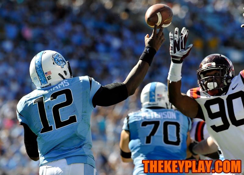 North Carolina Tar Heels quarterback Marquise Williams (12) throws a pass while under pressure from Virginia Tech Hokies defensive end Dadi Nicolas (90). (Michael Shroyer/ Thekeyplay.com)