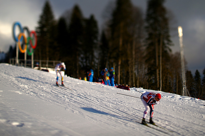 . (EDITORS NOTE: A TILT AND SHIFT LENS WAS USED IN THE CREATION OF THIS IMAGE) Skiers compete in the Finals of the Men\'s Sprint Free during day four of the Sochi 2014 Winter Olympics at Laura Cross-country Ski & Biathlon Center on February 11, 2014 in Sochi, Russia.  (Photo by Doug Pensinger/Getty Images)