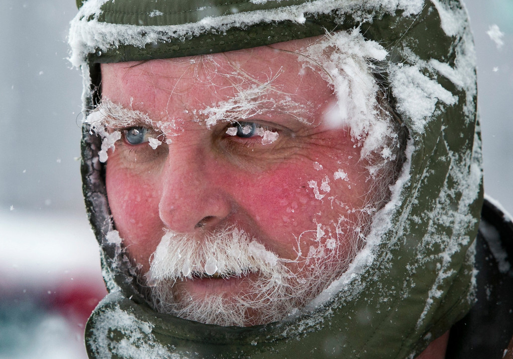 . Ice clings to Ken Anderson\'s eyebrows and mustache as he uses a snowblower during a blizzard, Saturday, Feb. 9, 2013, in Portland, Maine. The storm dumped more than 30 inches of snow as of Saturday afternoon, breaking the record for the biggest storm on record. (AP Photo/Robert F. Bukaty)