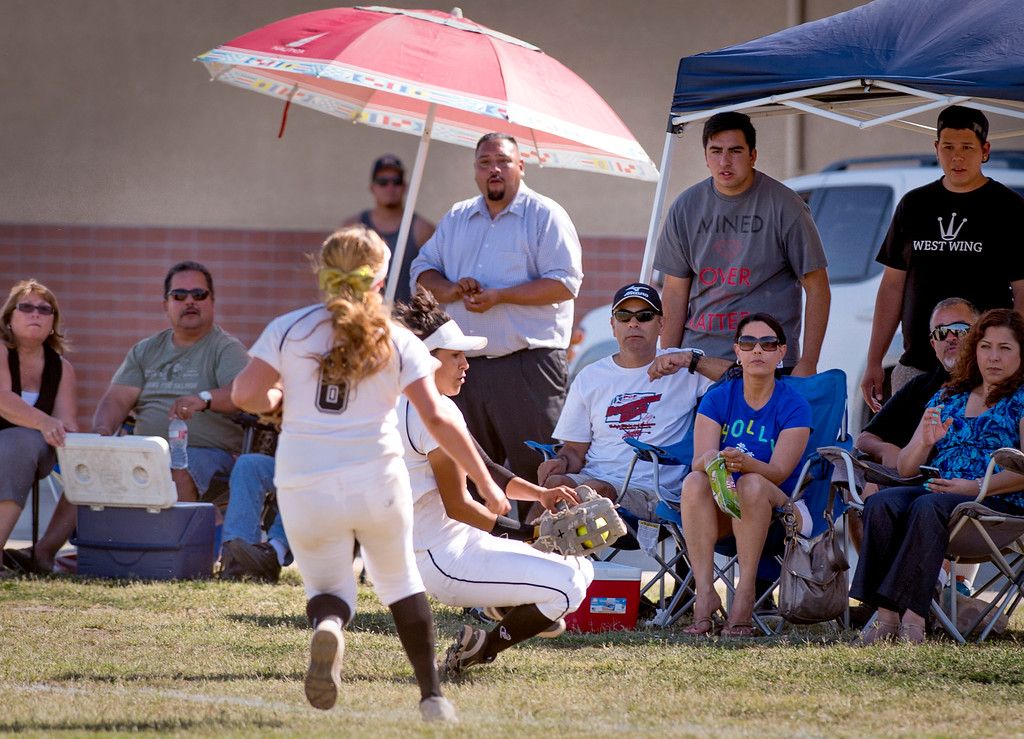 . Santa Fe High right fielder Yulissa Dominguez makes a sliding catch vs California High at the Santa Fe Springs campus field May 13, 2014.   (Staff photo by Leo Jarzomb/Whittier Daily News)