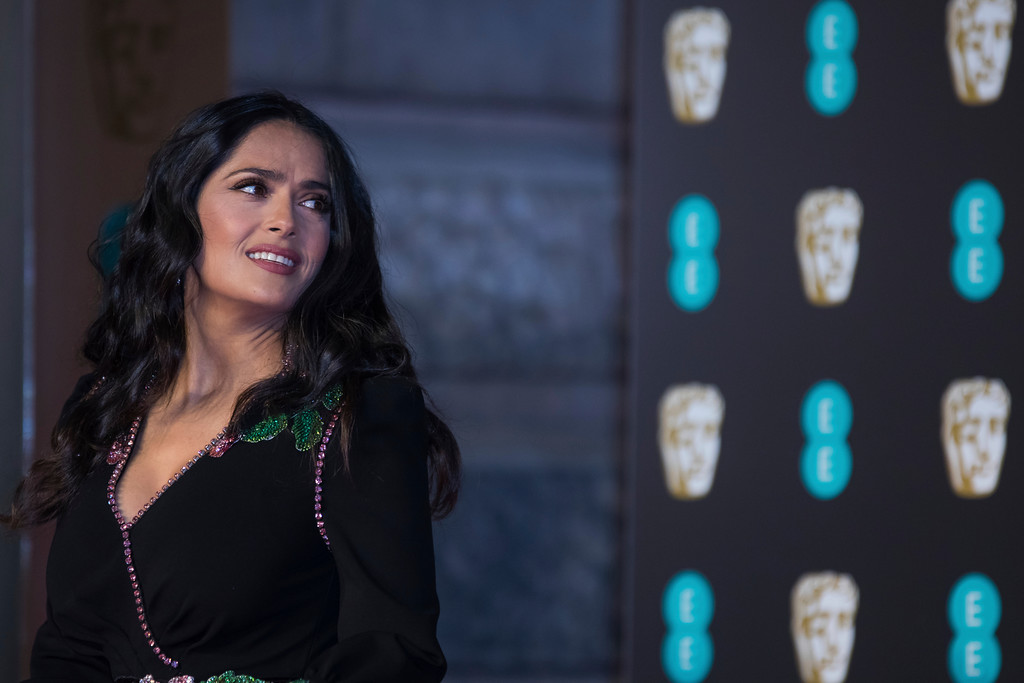 . Actress Salma Hayek poses for photographers upon arrival at the BAFTA Awards 2018 in London, Sunday, Feb. 18, 2018. (Photo by Vianney Le Caer/Invision/AP)
