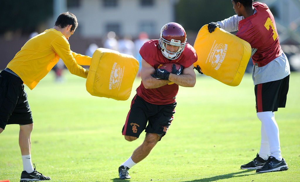 . USC\'s Christian Tober carries the ball during spring practice at USC Monday, April 1, 2014. (Andy Holzman/Los Angeles Daily News)
