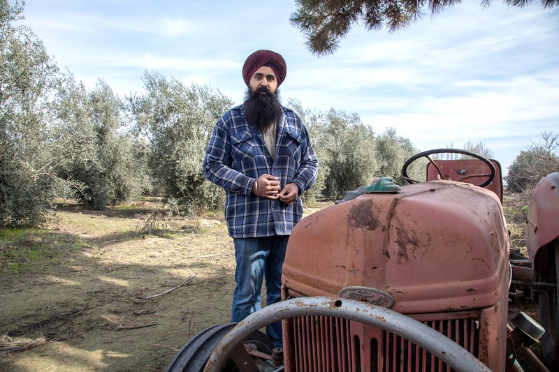 Kanwarjit Boparai bought an old tractor from a neighbor, and he uses it to knock down weeds.